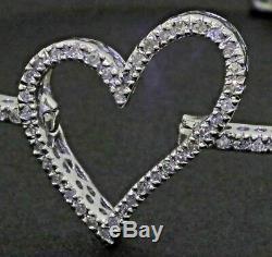 14K white gold lovely elegant. 82CT diamond heart bangle bracelet