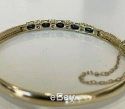 9ct solid gold with Sapphire & white stone bangle 8.30g